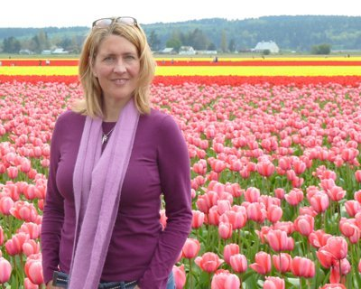 cami ostman in field of tulips